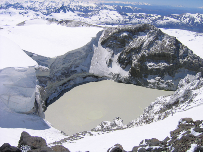 The massive and impressive glacial lake in the crater of Volcan Copahue.
